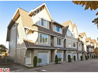 "Photo 1: 100 15175 62A Avenue in Surrey: Sullivan Station Townhouse for sale in ""Brooklands"" : MLS®# F1127771"