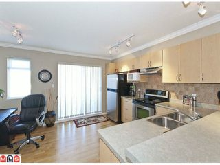 "Photo 3: 100 15175 62A Avenue in Surrey: Sullivan Station Townhouse for sale in ""Brooklands"" : MLS®# F1127771"