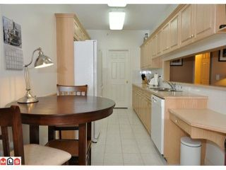 "Photo 2: 423 13880 70TH Avenue in Surrey: East Newton Condo for sale in ""CHELSEA GARDENS"" : MLS®# F1200411"