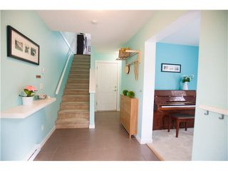 "Photo 2: 74 101 FRASER Street in Port Moody: Port Moody Centre Townhouse for sale in ""CORBEAU"" : MLS®# V1116275"