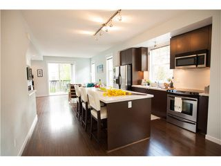 """Photo 4: 74 101 FRASER Street in Port Moody: Port Moody Centre Townhouse for sale in """"CORBEAU"""" : MLS®# V1116275"""
