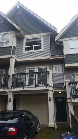 "Photo 1: 28 15065 58 Avenue in Surrey: Sullivan Station Townhouse for sale in ""SPRINGHILL"" : MLS®# R2026880"