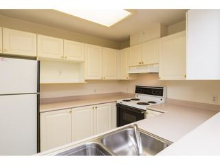 "Photo 11: 207 9767 140 Street in Surrey: Whalley Condo for sale in ""FRASER GATE"" (North Surrey)  : MLS®# R2145386"