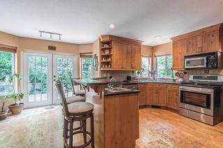 """Photo 7: 1026 PIA Road in Squamish: Garibaldi Highlands House for sale in """"Garibaldi Highlands"""" : MLS®# R2271862"""