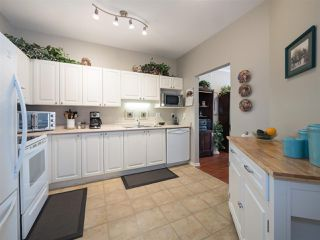 "Photo 2: 403 3172 GLADWIN Road in Abbotsford: Central Abbotsford Condo for sale in ""REGENCY PARK"" : MLS®# R2314981"