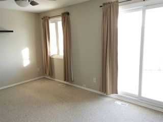 Photo 10: 427 DUNLUCE Road in Edmonton: Zone 27 Townhouse for sale : MLS®# E4143891