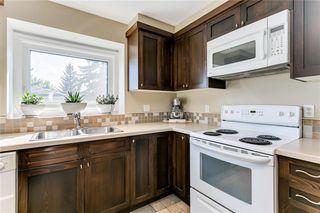 Photo 7: 127 MILLSIDE Drive SW in Calgary: Millrise Detached for sale : MLS®# C4264789