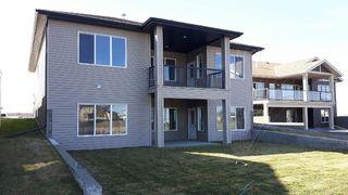 Photo 2: 10506 103 Avenue: Morinville House Duplex for sale : MLS®# E4188229