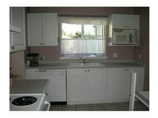 """Photo 3: 20 2488 PITT RIVER Road in Port Coquitlam: Mary Hill Townhouse for sale in """"NEW CASTLE ESTATES"""" : MLS®# V1106167"""