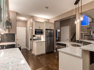 Photo 6: 230 ROCKY RIDGE Mews NW in Calgary: Rocky Ridge Ranch House for sale : MLS®# C4008870