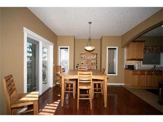 Photo 9: 52 BOW RIDGE Drive: Cochrane House for sale : MLS®# C4066881