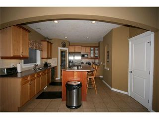 Photo 11: 52 BOW RIDGE Drive: Cochrane House for sale : MLS®# C4066881