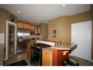 Photo 12: 52 BOW RIDGE Drive: Cochrane House for sale : MLS®# C4066881