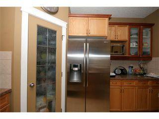 Photo 13: 52 BOW RIDGE Drive: Cochrane House for sale : MLS®# C4066881