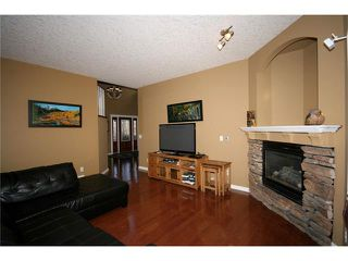 Photo 7: 52 BOW RIDGE Drive: Cochrane House for sale : MLS®# C4066881