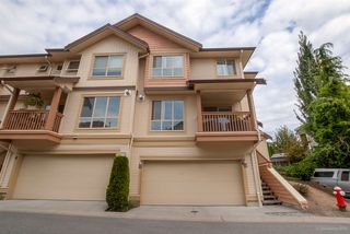 """Photo 1: 64 20350 68 Avenue in Langley: Willoughby Heights Townhouse for sale in """"SUNRIDGE"""" : MLS®# R2109744"""
