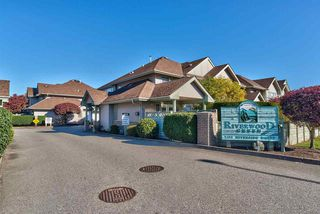 "Photo 1: 5 1255 RIVERSIDE Drive in Port Coquitlam: Riverwood Townhouse for sale in ""Riverwood Green"" : MLS®# R2338733"