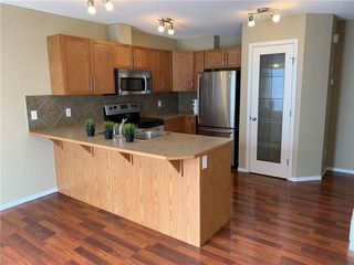 Photo 2: 704 800 YANKEE VALLEY Boulevard SE: Airdrie Row/Townhouse for sale : MLS®# C4242529