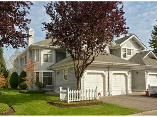 "Photo 1: 17 5708 208TH Street in Langley: Langley City Townhouse for sale in ""Bridle Run"" : MLS®# F1424617"