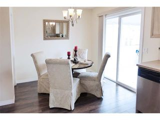 Photo 4: 56 MARTIN CROSSING Crescent NE in Calgary: Martindale House for sale : MLS®# C4019919