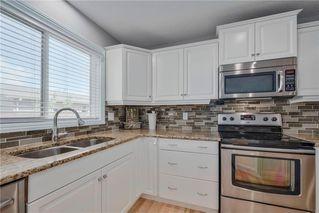 Photo 8: 208 PRESTWICK MR SE in Calgary: McKenzie Towne House for sale : MLS®# C4130240