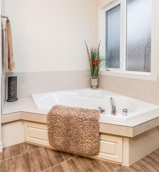 Photo 11: 256 EVERGREEN Plaza SW in Calgary: Evergreen House for sale : MLS®# C4144042