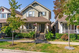 """Photo 1: 19083 69A Avenue in Surrey: Clayton House for sale in """"Clayton"""" (Cloverdale)  : MLS®# R2303297"""
