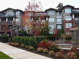 "Photo 1: 211 15188 29A Avenue in Surrey: King George Corridor Condo for sale in ""South Point Walk"" (South Surrey White Rock)  : MLS®# R2324258"