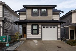 "Main Photo: 2 47042 MACFARLANE Place in Sardis: Promontory Townhouse for sale in ""South Ridge"" : MLS®# R2324819"