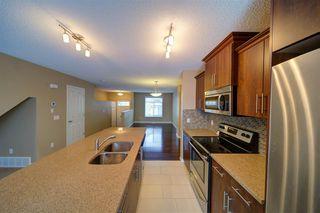 Photo 2: 36 465 HEMINGWAY Road in Edmonton: Zone 58 Townhouse for sale : MLS®# E4139832