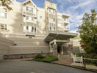 "Main Photo: 210 3033 TERRAVISTA Place in Port Moody: Port Moody Centre Condo for sale in ""GLENMORE"" : MLS®# R2411326"