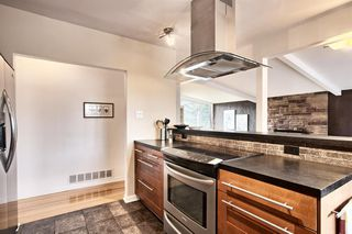 Photo 14: 4703 Chapel Road NW in Calgary: Charleswood Detached for sale : MLS®# A1041619