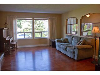 Photo 2: 1602 HEMLOCK Place in Port Moody: Mountain Meadows House for sale : MLS®# V927429