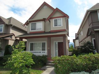 "Photo 1: #13 45450 SHAWNIGAN CR in CHILLIWACK: Vedder S Watson-Promontory House for rent in ""SININGER PLACE"" (Sardis)"