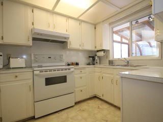 Photo 6: 151 LAKE ADAMS Crescent SE in Calgary: Lake Bonavista Residential Detached Single Family for sale : MLS®# C3648155
