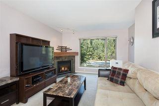 """Photo 2: 211 2323 MAMQUAM Road in Squamish: Garibaldi Highlands Condo for sale in """"SYMPHONY"""" : MLS®# R2206752"""