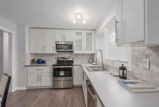 Photo 1: 875 PINECLIFF DR NE in Calgary: Pineridge House for sale : MLS®# C4123364