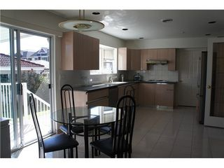 Photo 7: 6438 QUEBEC Street in Vancouver East: Home for sale : MLS®# V984500