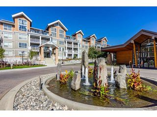 "Photo 2: 415 6490 194 Street in Surrey: Clayton Condo for sale in ""Waterstone"" (Cloverdale)  : MLS®# R2411705"