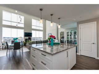 """Main Photo: 415 6490 194 Street in Surrey: Clayton Condo for sale in """"Waterstone"""" (Cloverdale)  : MLS®# R2411705"""