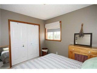 Photo 10: 128 QUIGLEY Close: Cochrane Residential Attached for sale : MLS®# C3605287
