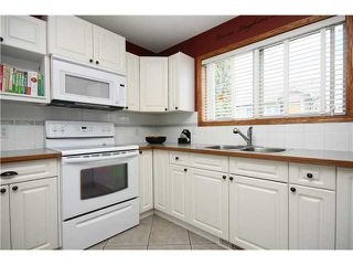 Photo 8: 128 QUIGLEY Close: Cochrane Residential Attached for sale : MLS®# C3605287