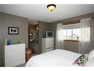 Photo 14: 128 QUIGLEY Close: Cochrane Residential Attached for sale : MLS®# C3605287
