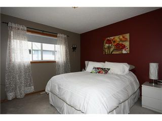 Photo 13: 128 QUIGLEY Close: Cochrane Residential Attached for sale : MLS®# C3605287