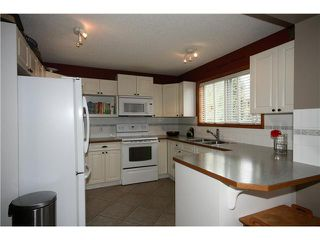 Photo 7: 128 QUIGLEY Close: Cochrane Residential Attached for sale : MLS®# C3605287