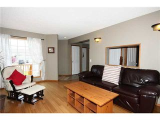 Photo 4: 128 QUIGLEY Close: Cochrane Residential Attached for sale : MLS®# C3605287