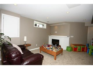 Photo 16: 128 QUIGLEY Close: Cochrane Residential Attached for sale : MLS®# C3605287