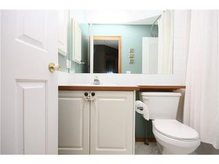 Photo 12: 128 QUIGLEY Close: Cochrane Residential Attached for sale : MLS®# C3605287