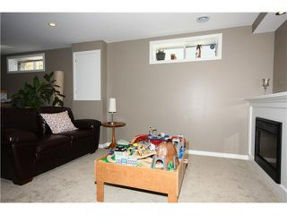 Photo 17: 128 QUIGLEY Close: Cochrane Residential Attached for sale : MLS®# C3605287
