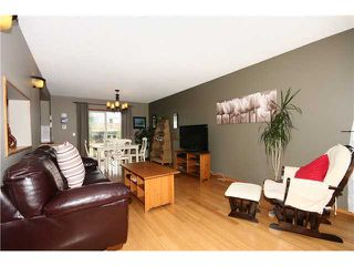 Photo 5: 128 QUIGLEY Close: Cochrane Residential Attached for sale : MLS®# C3605287